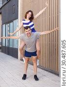 Купить «Young loving couple have a good time», фото № 30487605, снято 27 июня 2018 г. (c) Яков Филимонов / Фотобанк Лори