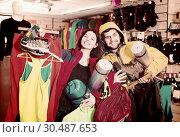 Купить «Smiling couple demonstration new tourist equipment», фото № 30487653, снято 8 марта 2017 г. (c) Яков Филимонов / Фотобанк Лори
