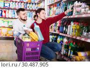 Купить «two attentive adult people in good spirits selecting detergents in the store», фото № 30487905, снято 14 марта 2017 г. (c) Яков Филимонов / Фотобанк Лори