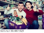 Купить «cheerful family choosing purchasing canned food for week at supermarket», фото № 30487929, снято 14 марта 2017 г. (c) Яков Филимонов / Фотобанк Лори