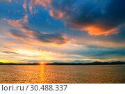 Купить «Sea sunset landscape - sea waters lit by sunset summer light. Summer sunny water scene in colorful tones. Sea summer nature with mountain range at the horizon», фото № 30488337, снято 26 августа 2013 г. (c) Зезелина Марина / Фотобанк Лори