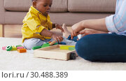 Купить «mother and baby playing with toy blocks at home», видеоролик № 30488389, снято 24 марта 2019 г. (c) Syda Productions / Фотобанк Лори
