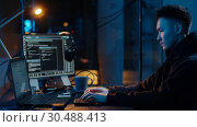 Купить «hacker using computer for cyber attack at night», видеоролик № 30488413, снято 30 марта 2019 г. (c) Syda Productions / Фотобанк Лори