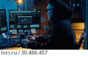 Купить «hacker using computer for cyber attack at night», видеоролик № 30488457, снято 30 марта 2019 г. (c) Syda Productions / Фотобанк Лори