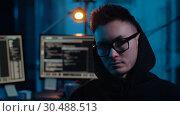Купить «asian hacker in dark room with computers at night», видеоролик № 30488513, снято 30 марта 2019 г. (c) Syda Productions / Фотобанк Лори