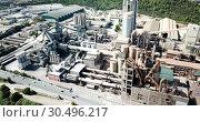 Купить «Aerial view of cement production plant», видеоролик № 30496217, снято 26 августа 2018 г. (c) Яков Филимонов / Фотобанк Лори