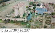 Купить «Aerial view of medieval fortification Chateau Sarzay in France», видеоролик № 30496237, снято 25 октября 2018 г. (c) Яков Филимонов / Фотобанк Лори