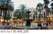 Купить «Evening view of Placa Reial with restaurants in summer. Barcelona, Spain», видеоролик № 30496285, снято 21 августа 2018 г. (c) Яков Филимонов / Фотобанк Лори