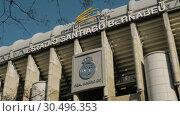 Купить «Santiago Bernabeu Stadium and Real Madrid logo in Spain», видеоролик № 30496353, снято 17 января 2018 г. (c) Данил Руденко / Фотобанк Лори