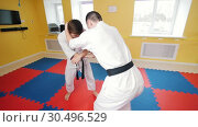 Martial arts. Two athletic men training their aikido skills. Hitting the opponent with a knee. Стоковое видео, видеограф Константин Шишкин / Фотобанк Лори