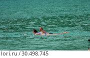 Купить «Surfers on the waves», видеоролик № 30498745, снято 16 ноября 2018 г. (c) Игорь Жоров / Фотобанк Лори