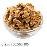 Купить «Glass bowl with walnuts on white», фото № 30500105, снято 23 августа 2019 г. (c) Яков Филимонов / Фотобанк Лори