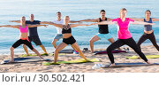 Купить «Women and men during training on beach», фото № 30502421, снято 14 июня 2017 г. (c) Яков Филимонов / Фотобанк Лори