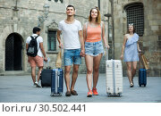 Купить «Young traveling people taking promenade with luggage», фото № 30502441, снято 22 июня 2017 г. (c) Яков Филимонов / Фотобанк Лори