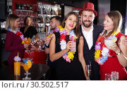 Купить «Man and two women on Hawaiian party at nightclub», фото № 30502517, снято 29 ноября 2017 г. (c) Яков Филимонов / Фотобанк Лори