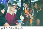 Купить «Woman with friends at nightclub», фото № 30502529, снято 29 ноября 2017 г. (c) Яков Филимонов / Фотобанк Лори