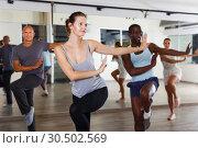 Купить «dancing people practicing vigorous swing», фото № 30502569, снято 30 июля 2018 г. (c) Яков Филимонов / Фотобанк Лори