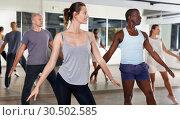 Купить «People dancing lindy hop during group training», фото № 30502585, снято 30 июля 2018 г. (c) Яков Филимонов / Фотобанк Лори