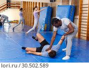 Купить «Two men practicing self defense techniques», фото № 30502589, снято 31 октября 2018 г. (c) Яков Филимонов / Фотобанк Лори