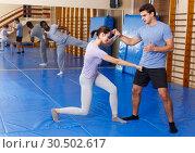 Купить «People practicing self defense techniques», фото № 30502617, снято 31 октября 2018 г. (c) Яков Филимонов / Фотобанк Лори