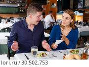 Купить «Visitors demonstrating dissatisfaction with prices of dishes», фото № 30502753, снято 26 октября 2018 г. (c) Яков Филимонов / Фотобанк Лори