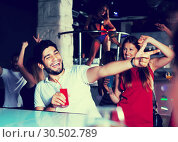 Купить «People joying in nightclub», фото № 30502789, снято 28 августа 2017 г. (c) Яков Филимонов / Фотобанк Лори