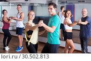 Купить «Men and women dancing salsa o bachata», фото № 30502813, снято 27 мая 2019 г. (c) Яков Филимонов / Фотобанк Лори