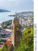 Купить «St. John and Chapel of Salvation of Virgin on Mount Pestingrad against picturesque bay. Kotor. Montenegro», фото № 30502997, снято 11 июля 2015 г. (c) Papoyan Irina / Фотобанк Лори