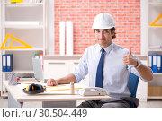 Купить «Construction supervisor working on blueprints», фото № 30504449, снято 13 сентября 2018 г. (c) Elnur / Фотобанк Лори
