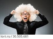 Купить «Young man wearing afro wig», фото № 30505681, снято 15 июня 2014 г. (c) Elnur / Фотобанк Лори