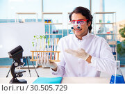 Купить «Male biotechnology scientist chemist working in the lab», фото № 30505729, снято 20 ноября 2018 г. (c) Elnur / Фотобанк Лори