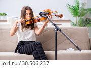 Купить «Female beautiful musician playing violin at home», фото № 30506237, снято 1 октября 2018 г. (c) Elnur / Фотобанк Лори