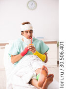 Купить «Young injured man staying in the hospital», фото № 30506401, снято 2 октября 2018 г. (c) Elnur / Фотобанк Лори