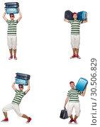 Купить «Young man with heavy suitcases isolated on white», фото № 30506829, снято 24 апреля 2019 г. (c) Elnur / Фотобанк Лори
