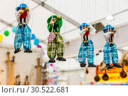 Купить «Russia, Samara, March 2017: sale of puppets at the fair. A puppet is a kind of controlled Theater doll with the help of a rope.», фото № 30522681, снято 19 марта 2017 г. (c) Акиньшин Владимир / Фотобанк Лори