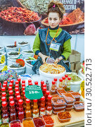 Купить «Russia, Samara, March 2017: Products of Abkhazia at the fair. Tea, sauces, spices. Text in Russian: classic tkemali sauce», фото № 30522713, снято 19 марта 2017 г. (c) Акиньшин Владимир / Фотобанк Лори