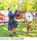Купить «Russia, Samara, September 2018: Spectacular staged battles of Slavic warriors and knights at the festival in Zagorodny Park.», фото № 30522845, снято 16 сентября 2018 г. (c) Акиньшин Владимир / Фотобанк Лори