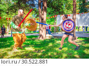 Купить «Russia, Samara, September 2018: Spectacular staged battles of Slavic warriors and knights at the festival in Zagorodny Park.», фото № 30522881, снято 16 сентября 2018 г. (c) Акиньшин Владимир / Фотобанк Лори