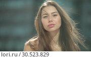 Купить «Portrait of a beautiful young woman, the wind blows hair.», видеоролик № 30523829, снято 4 апреля 2019 г. (c) Женя Канашкин / Фотобанк Лори