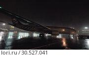 Купить «Airplane pushback at the airport, view at rainy night», видеоролик № 30527041, снято 31 октября 2017 г. (c) Данил Руденко / Фотобанк Лори