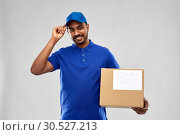 Купить «happy indian delivery man with parcel box in blue», фото № 30527213, снято 12 января 2019 г. (c) Syda Productions / Фотобанк Лори