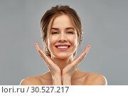 Купить «smiling young woman over grey background», фото № 30527217, снято 20 января 2019 г. (c) Syda Productions / Фотобанк Лори