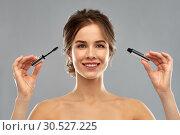 Купить «woman with mascara applying make up», фото № 30527225, снято 20 января 2019 г. (c) Syda Productions / Фотобанк Лори