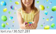 Купить «close up of girl holding chocolate easter eggs», фото № 30527281, снято 25 июля 2018 г. (c) Syda Productions / Фотобанк Лори