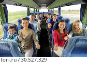 Купить «group of happy passengers travelling by bus», фото № 30527329, снято 21 октября 2015 г. (c) Syda Productions / Фотобанк Лори