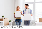 Купить «happy couple with boxes moving to new home», фото № 30527345, снято 25 февраля 2016 г. (c) Syda Productions / Фотобанк Лори