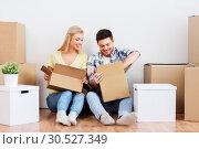 Купить «happy couple unpacking boxes at new home», фото № 30527349, снято 25 февраля 2016 г. (c) Syda Productions / Фотобанк Лори