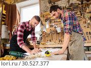 Купить «carpenters with ruler and coffee at workshop», фото № 30527377, снято 14 мая 2016 г. (c) Syda Productions / Фотобанк Лори