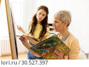 Купить «senior woman painting at art school studio», фото № 30527397, снято 26 мая 2017 г. (c) Syda Productions / Фотобанк Лори
