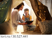 Купить «family with tablet pc in kids tent at home», фото № 30527441, снято 27 января 2018 г. (c) Syda Productions / Фотобанк Лори